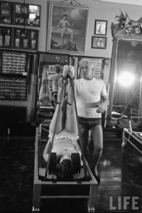 Joseph Pilates teaching on the reformer