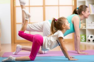 Mother and kid doing Pilates